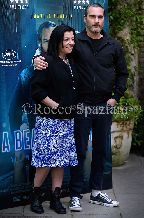 Actor Joaquin Phoenix  Director Lynne Ramsay attends 'A Beautiful Day' photocall at Hotel De Russie on April 27, 2018 in Rome, Italy