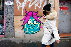 Glasgow, Scotland, UK.1 December 2020. Coronavirus health warnings, shop display and graffiti in Glasgow city centre. Pictured; Coronavirus graffiti on a Glasgow Street.  Iain Masterton/Alamy Live News