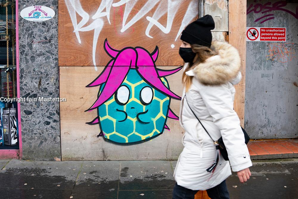 Glasgow, Scotland, UK.1 December 2020. Coronavirus health warnings, shop display and graffiti in Glasgow city centre. Pictured; Coronavirus graffiti on a Glasgow Street.  Iain Masterton/Alamy Live News