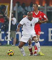 Photo: Steve Bond/Richard Lane Photography.<br />Ghana v Namibia. Africa Cup of Nations. 24/01/2008. Junior Agogo (front) shields the ball from Brian Guilbert Brendell (back)