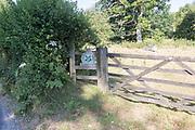 National Trust sign at an entrance to Lockeridge Dene, near Marlborough, Wiltshire, England, UK