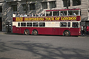 Open topped red double decker tour bus in central London, England