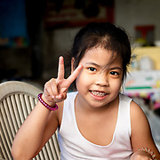 Portrait of young Thai girl in Thon Buri neighbourhood of Bangkok
