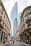 A man walks across the road in what would normally be the morning rush hour in the City of London on March 17th, 2020. The financial district of the UK is unusually quiet after the government requested people to refrain from all but essential travel and activities yesterday.
