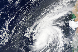 Hurricanes in the Atlantic Ocean typically start to develop off the west coast of Africa, then move westward across the basin and intensify as they approach North America or the islands of the Caribbean and Gulf of Mexico. In the last days of August 2015, that storm development process went into overdrive.<br /> On August 30, an easterly wave from the African interior moved out over the Atlantic, where sea surface temperatures hovered around 30° Celsius (86° Fahrenheit). The unusually warm waters provided fuel for a storm that progressed from tropical depression to tropical storm to hurricane in roughly one day.<br /> According to several reports, Fred appears to be the easternmost hurricane to form in the tropical Atlantic during the satellite era. (Extra-tropical Hurricane Vince formed briefly off Portugal in 2005.) It is also believed to be the first hurricane to hit Cabo Verde (Cape Verde) islands since 1892. The storm did not cause any casualties, nor did it make direct landfall on any of the islands, but it did cause flash flooding and extensive wind damage. As much rain was predicted to fall in one day as the islands typically receive in half a year, though totals are not yet available.<br /> The Moderate Resolution Imaging Spectroradiometer (MODIS) on NASA's Terra satellite acquired this natural-color image of Fred off the west coast Africa at 11:15 a.m. Cabo Verde time (12:15 Universal Time) on August 31, 2015. The storm was at peak intensity when the image was acquired, with sustained wind speeds of 75 knots (85 miles or 140 kilometers per hour) and a central pressure of 986 millibars. It was a category 1 storm on the Saffir-Simpson scale.<br /> The MODIS instrument on Terra got a look at Fred's remnants on September 1. Now a tropical storm, it is expected to linger for much of the week and slowly devolve into a tropical depression as it moves north and west.<br /> References<br /> BBC (2015, September 1)<br /> Hurricane Fred hits Cape Verde. Accessed Sept