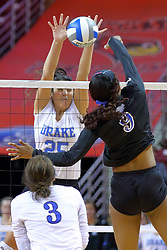 23 November 2017:  Stephanie Bindemagel watches Damadj Johnson strike into the hands of blocker Cathryn Cheek during a college women's volleyball match between the Drake Bulldogs and the Indiana State Sycamores in the Missouri Valley Conference Tournament at Redbird Arena in Normal IL (Photo by Alan Look)