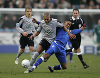 Photo: Lee Earle.<br /> Millwall v Everton. The FA Cup. 07/01/2006.Everton's Marcus Bent (L) battles with Marvin Elliott.