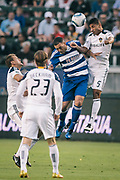 Los Angeles Galaxy defender Sean Franklin, right, wins the ball over FC Dallas midfielder Daniel Hernandez during the first half of an MLS soccer match, Saturday, Aug. 6, 2011, in Carson, Calif. (AP Photo/Bret Hartman)