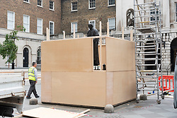 © Licensed to London News Pictures. 12/06/2020. London, UK.  Workmen board up the statue of Thomas Guy at Guys And St Thomas's Hospital Trust after pressure from anti-racist groups recognise the legacy of colonialism, racism and slavery. In London, Britain, Jun 12, 2020. In a statement, the hospital trust had recognised the legacy of colonialism, racism and slavery of Thomas Guy. Photo credit: Ray Tang/LNP