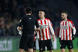(L-R), Referee Dennis Higler, Hirving Lozano of PSV during the Dutch Eredivisie match between PSV Eindhoven and sc Heerenveen at the Phillips stadium on February 17, 2018 in Eindhoven, The Netherlands