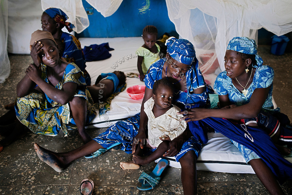 Women with their children are sitting on the floor of the Medecins Sans Frontieres (MSF - Doctors Without Borders) clinic in Anka, Zamfara State, Nigeria, handling serious cases of lead poisoning referred to them by local clinics in the surrounding villages. It is mainly caused by ingestion and breathing of lead particles released in the steps to isolate the gold from other metals. This type of lead is soluble in stomach acid and children under-5 are most affected, as they tend to ingest more through their hands by touching the ground, and are developing symptoms often leading to death or serious disabilities. The treatment with MSF starts when blood lead level (BLL) samples reach 45 micrograms per decilitre. The Centers for Disease Control and Prevention (CDC) states that a BLL of 5 micro-g/dL or above is a cause for concern. The cycle of medicines lasts for 20 days. After that, the child's blood is tested and a new round of treatment is provided. Treatment can last years, as lead is reduced in the blood, but it persists noticeably within the bones, especially if the patients return to the same polluted environment. Remediation of the affected villages, a campaign of awareness, and the introduction of safer mining techniques are pivotal to the long-term solution of a hazardous trend that has already killed over 460 children, and it is bound to grow in size, fostered by the ever-rising price of gold.