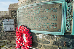 "The war memorial, in the form of a large round tower, is situated at Lazaretto Point on the southwest shore of the Holy Loch between Ardnadam and Sandbank. Built during the 1920s, to commemorate those who fell in World War One. A bronze plaque was later added to the front of the tower and marks the sacrifice of the ""officers and men of the Sandbank and district who died in their country's service"" during the Second World War.<br /> On a low wall to the towers left is a polished stone marker baring the black and red badge of the Combined Operations. erected to mark the 70th anniversary of Operation Frankton the memorial is dedicated to the memory of ""The Royal Marines boom patrol, The Cockleshell Heroes"" who sailed from Holy Loch to take part in the operation. <br /> <br /> 04 April  2015<br /> Image © Paul David Drabble <br /> www.pauldaviddrabble.co.uk"