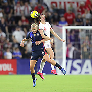 United States midfielder Lindsey Horan (9) and England midfielder Jill Scott (8) fight for the ball during the first match of the 2020 She Believes Cup soccer tournament at Exploria Stadium on 5 March 2020 in Orlando, Florida USA.