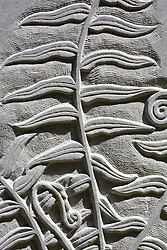 Details of stone monolith with carved fern foliage
