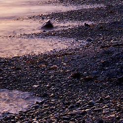 Fort Foster, Kittery, ME. Reflections and rocks form abstract patterns in the beach.