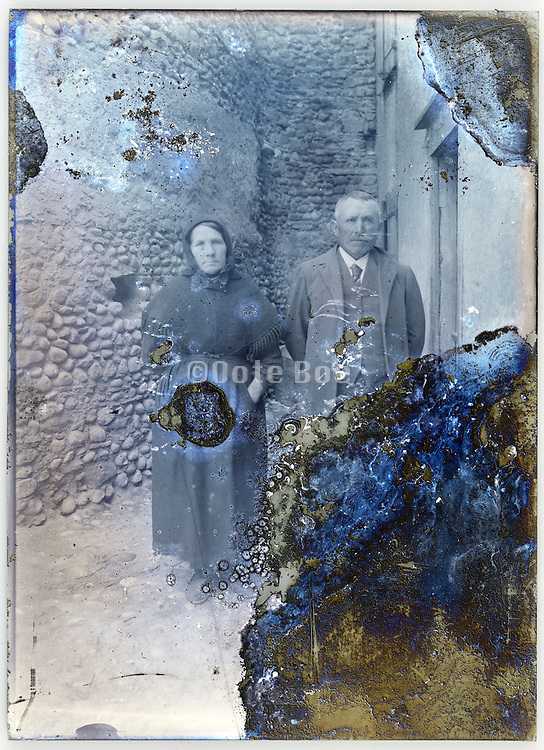 severely eroding glass plate with elderly couple