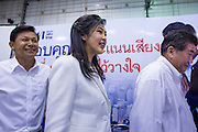 03 MARCH 2013 - BANGKOK, THAILAND: .PONGSAPAT PONGCHAREON, left, the Pheu Thai candidate for Governor of Bangkok, YINGLUCK SHINAWATRA, the Thai Prime Minister, and members of the Pheu Thai leadership leave the press conference announcing that Pongsapat lost the Bangkok Governor's election. Pongsapat Pongchareon, running on the Pheu Thai ticket, lost the Bangkok's Governor's race to MR Sukhumbhand Paribatra, the incumbent running on the Democrat ticket. Sukhumbhand won the race after scoring a record number of votes, more than 1.2 million to Pongsapat's 1 million. The results were seen as an upset even though Sukhumbhand was the incumbent because all of the pre-election polls and the exit polls conducted on election day showed Patsapong winning.     PHOTO BY JACK KURTZ