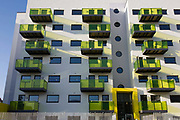 New apartments in a block developed by Skanska in Coldharbour Lane in Camberwell, Lambeth, South London. The new building's balconies have fluouerscent green that looks garish in the afternoon sunlight, similar to the high-visibility tabards of nearby constructions workers. Whilst known mainly for large high-profile schemes, Skanska also undertake many smaller projects including public realm improvements, involved in some of the UK's most prestigious projects in both the Private and Public Sectors.