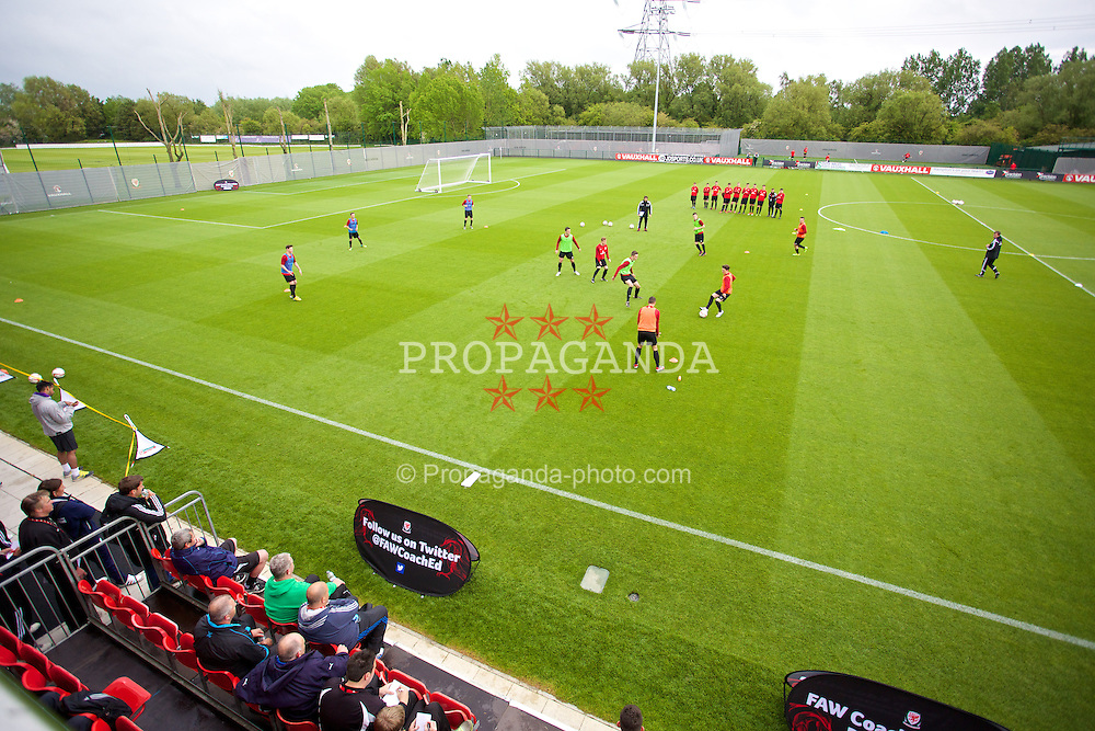 CHEPSTOW, WALES - Friday, May 23, 2014: Benfica Youth Development coach Joao Tralhao gives a practical demonstration during the Football Association of Wales' National Coaches Conference 2014 at Dragon Park FAW National Development Centre. (Pic by David Rawcliffe/Propaganda)