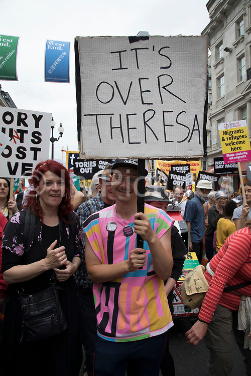 Peoples Assembly National Demonstration Against Theresa May and Austerity - Not One Day More - Tories Out, onSaturday July 1st in London, United Kingdom. Tens of thousands of people gathered to protest in a march through the capital protesting against the Conservative Party cuts. Following the recent General Election where the Labour Party gained seats, while the Conservative Party lost their majority, the mood in the country has been one where an anti-austerity movement is growing as people become tired with Tory rule.