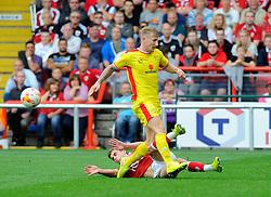 Bristol City's Joe Bryan tackles Milton Keynes Dons' Kyle McFadzean  - Photo mandatory by-line: Joe Meredith/JMP - Mobile: 07966 386802 - 27/09/2014 - SPORT - Football - Bristol - Ashton Gate - Bristol City v MK Dons - Sky Bet League One