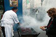 Sausages being cooked by a vendor during the annual Fete de la Musique. Paris, France. (Supporting image from the project Hungry Planet: What the World Eats)