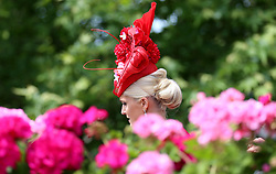 A fashionable racegoer arrives during day five of Royal Ascot at Ascot Racecourse.
