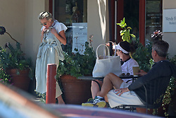 """EXCLUSIVE: Ellen DeGeneres and Portia DeRossi who have been staying inside their fancy home in Santa Barbara, take a break from being cooped up what Ellen described as, her """"prison"""" and head out in their convertible Porsche. Ellen has come under fire in recent weeks, first for describing her home as being like a """"prison"""" which made her seem out of touch, to fans. And then more recently comedian, Kevin T. Porter crowdsourced """"insane stories you've heard about Ellen being mean"""" in exchange for $2 donations to the Los Angeles Regional Food Bank — and received thousands of responses. Amidst all this public hostility, the 62 year-old comedian and her 47 year-old wife are spotted enjoying a bit of a wander around Santa Barbara on Memorial Day while wearing masks to guard against possible spreading coronavirus. At one point Portia stopped by Wendy Foster and showed Ellen, who was drinking an iced-tea, a dress she like while draping it across her body, much to the amusement of a pair of (unmasked) onlookers. 23 May 2020 Pictured: Portia DeRossi. Photo credit: Rachpoot/P&P/MEGA TheMegaAgency.com +1 888 505 6342"""