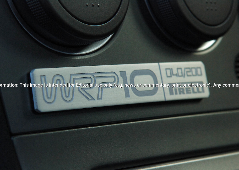 """Special WRP10 Badging.Subaru Impreza WRX WRP10 - a limited edition model exclusive to the Australian market. .The WRP10 was available from late January 2005 and was limited to 200 units, featuring individually numbered badges..The model name comes from Subaru's heritage, the """"WR"""" represents Impreza WRX's success in World Rally competition, """"P"""" the enormous rallying contribution from Pirelli tyres and """"10"""" the years since launch of the original Impreza WRX""""..Available exclusively in Crystal Grey Metallic manual sedan, the WRP10 includes a STI engine performance upgrade kit increasing peak power from standard WRX's 168 kW @ 6,000 rpm to175kW @ 6,000 rpm..The kit includes a replacement Electronic Control Unit, upgraded exhaust components and a unique large single tip muffler..A carbon fibre strut brace and WRX suspension lowering kit, with stiffer springs drop the car's ride height by 15mm..WRP10 is finished off with high performance, lightweight five-spoke forged alloy RAYS wheels and Pirelli P Zero Nero tyres (215 45Z R 17 91Y)..The limited edition model was the first developed by STI Australia, in conjunction with STI Japan .(C) Joel Strickland Photographics.Use information: This image is intended for Editorial use only (e.g. news or commentary, print or electronic). Any commercial or promotional use requires additional clearance."""