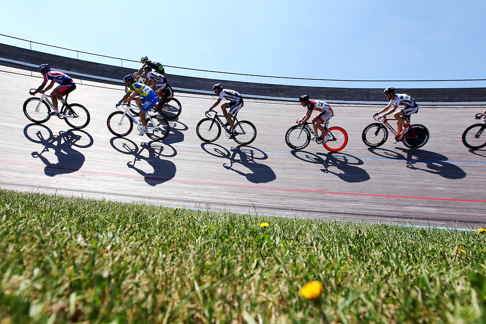 Riders warm up on the third day of racing at the Fixed Gear Classic, part of the Nature Valley Bicycle Festival, at the National Sports Center Velodrome in Blaine, Minnesota.