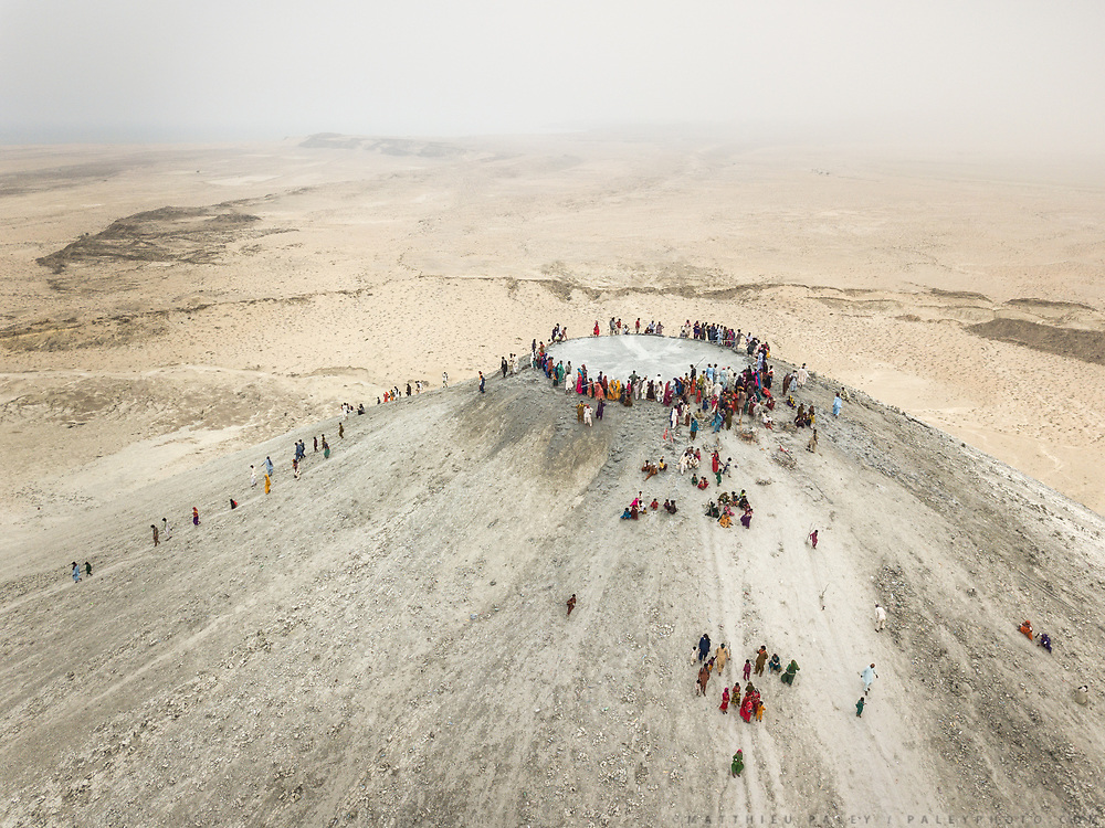 "The steep trek to the rim of the highest volcano is the first ritual of the Hinglaj pilgrimage. Pilgrims come up to throw a coconut in the cold mud (to thank the gods for granting their wish) and to apply the holy mud to their faces etc. The area around Chandragup (meaning ""Moon Well""), a sacred site to Hindu of 3 mud volcanoes (mainland Asia's largest ones)."