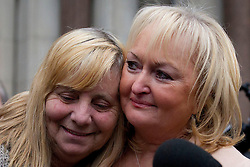 © Licensed to London News Pictures. 19/12/2012. London, UK. Margaret Aspinal (L) and Jenni Hicks (R) of the Hillsborough Family Support Group are seen outside the Royal Courts of Justice in London after the original accidental death ruling on the 1989 Hillsborough disaster was quashed by a judge today 19/12/12). The ruling on the disaster, in which 96 football fans were crushed to death during an FA Cup semi final between Liverpool and Nottingham Forest, opens the way for a new inquest. Photo credit: Matt Cetti-Roberts/LNP