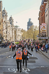 Orange men of the Orange order march along Whitehall after laying wreaths at the Cenotaph London.<br /> <br /> Richard Hancox | EEm 13042019