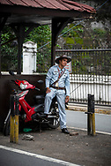 Manila, Philippines - July 27, 2019: At one of the gates leading into the old colonial district of Intramuros in Manila, a uniformed guard stands with his eyes on approaching traffic.