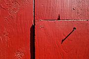 Nail in a red barn at Heath Fairgrounds in Heath, Massachusetts.