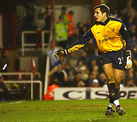 Photo. Javier Garcia<br />08/03/2003 Arsenal v Chelsea, FA Cup Quarter Final, Highbury<br />Carlo Cudicini throws an object to one side which was thrown by Chelsea fans
