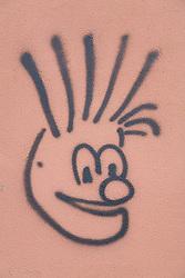 Graffiti face on a wall in Las Palmas; Las Palmas,