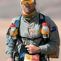 26 March 2007:  #725 Nigel Messervy of New Zealand runs across dunes near the end of the second stage (21.7 miles) of the 22nd Marathon des Sables between Khermou and jebel El Otfal. The Marathon des Sables is a 6 days and 151 miles endurance race with food self sufficiency across the Sahara Desert in Morocco. Each participant must carry his, or her, own backpack containing food, sleeping gear and other material.