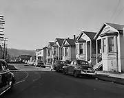 Y-510222-06.  slum area. NW Savier St. looking west from NW 23rd. Universal Bed Co., 2335 NW Savier. February 22, 1951
