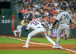 April 30, 2018 - Houston, TX, U.S. - HOUSTON, TX - APRIL 30:  Houston Astros first baseman Yuli Gurriel (10) gets an out on New York Yankees first baseman Neil Walker (14) in the top of the third inning during the baseball game between the New York Yankees and Houston Astros on April 30, 2018 at Minute Maid Park in Houston, Texas.  (Photo by Leslie Plaza Johnson/Icon Sportswire) (Credit Image: © Leslie Plaza Johnson/Icon SMI via ZUMA Press)