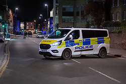 © Licensed to London News Pictures. 10/04/2021. London, UK. A police van blocks the road after a 17-year-old boy was fatally stabbed in Sydenham. Police were called to Hazel Grove, junction with Sydenham Road, at 19:19BST on Saturday, 10 April after reports of a male lying injured on the ground. Officers attended with medics from the London Ambulance Service and the London Air Ambulance. They found a 17-year-old male who had been stabbed. Despite the best efforts of the emergency services, he was pronounced dead shortly after 20:00hrs. His next of kin have been informed. Photo credit: Peter Manning/LNP