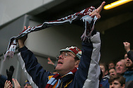 an Aston Villa fan cheering his teams win. EFL Skybet championship match, Queens Park Rangers v Aston Villa at Loftus Road Stadium in London on Sunday 18th December 2016.<br /> pic by Steffan Bowen, Andrew Orchard sports photography.