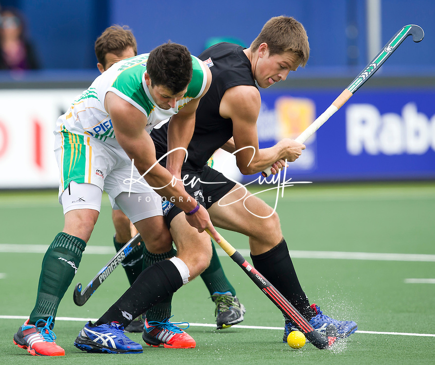 THE HAGUE - Marcus Child (r) and Lloyd Madsen . South Africa vs New Zealand during the Rabobank World Cup Hockey 2014. PHOTO KOEN SUYK