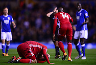 Sean Morrison of Cardiff City goes down after receiving a head injury .EFL Skybet championship match, Birmingham city v Cardiff city at St.Andrew's stadium in Birmingham, the Midlands on Friday 13th October 2017.<br /> pic by Bradley Collyer, Andrew Orchard sports photography.
