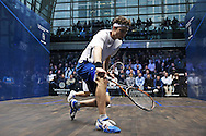 Cameron Piley of Australia (in the white shirt) playing a shot vs Mohaired Reda of Egypt (in the black shirt). Canary Wharf Squash Classic 2016 , day two at the East Wintergarden in Canary Wharf , London on Tuesday 8th March 2016.<br /> pic by John Patrick Fletcher, Andrew Orchard sports photography.