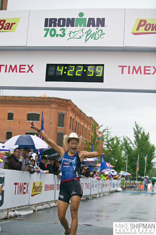 Idaho, Ada County, Boise, Boise 70.3 Ironman, Linsey Corbin from Missoula, MT, crosses the finish line in second place behind Magali Tisseyre with a time of 4:20:58