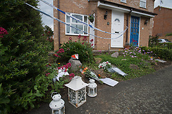© London News Pictures. 10/06/2012.  Ampthill, UK. Floral tributes left outside the property in Amphill, Bedfordshire, where 15-year-old Megan-Leigh Peat died in the early hours of Saturday morning. It is believed that Schoolgirl Megan-Leigh Peat was stabbed to death at a house party thrown by a boy whose parents are away on holiday. Photo credit: Ben Cawthra/LNP