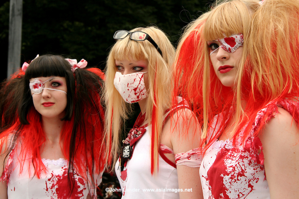"""Costume Play Bloody Nurses. A wide variety of """"costume play"""" getups are shown here: goths, cartoon characters from Japanese manga, anime,  the sweet-and-innocent frilly look or combinations in between (goth lolly)  Every Sunday, these cosplay characters converge on Harajuku, Tokyo's fashion quarter. Most casual observers say that cosplay is a reaction to the rigid rules of Japanese society. But since so many cosplay girls congregate in Harajuku and Aoyama - Tokyo headquarters of Fendi, Hanae Mori and Issey Miyake, others consider it is a reaction to high fashion. Whatever the cause, cosplay aficionados put a tremendous amount of effort into their costumes every Sunday. One wonders what they wear on Monday morning..."""