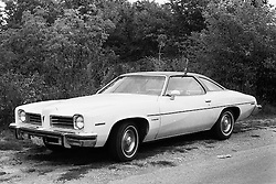 1975 - 1977 Heyworth Illinois<br /> 1974 Pontiac Lemans sitting along gravel road<br /> <br /> Archive slide, negative and print scans.
