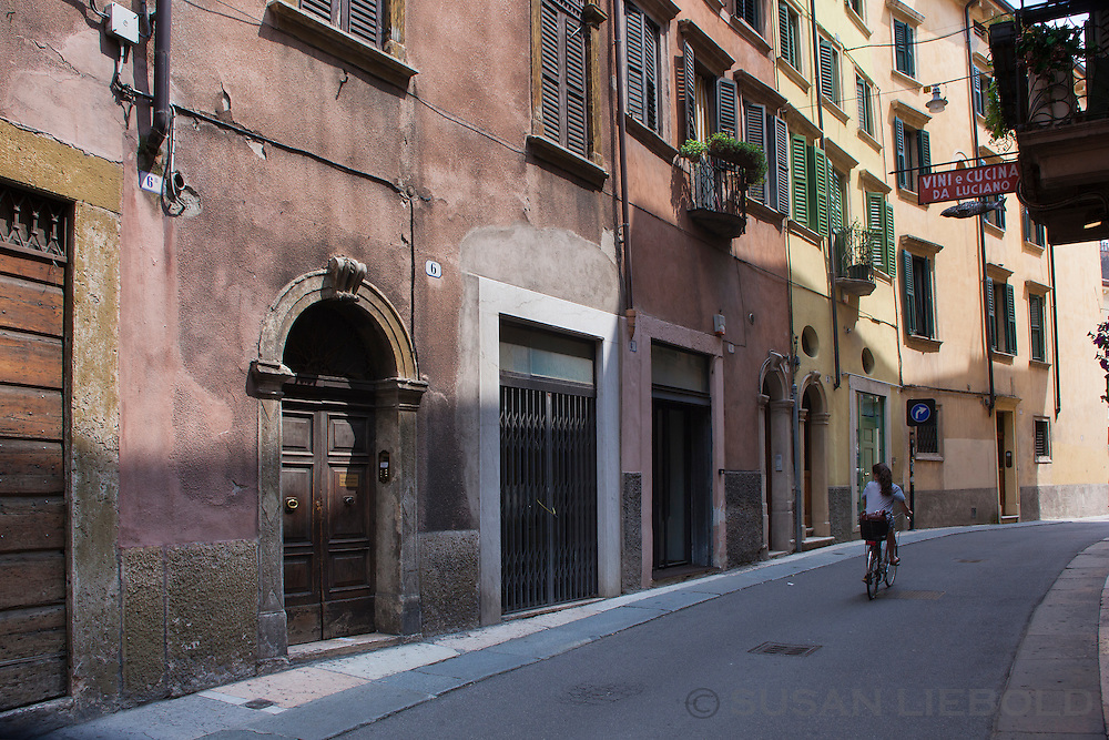 A girl on a bicycle in Verona, Italy.